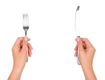 A knife and fork in hands Royalty Free Stock Photos