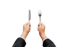Knife and fork in hands Stock Image