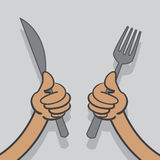 Knife and Fork Hands. Hands holding up a knife and fork Stock Image