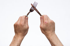 Knife and fork in hands Royalty Free Stock Photos
