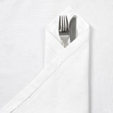 Knife and fork with linen serviette Stock Images