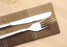 Knife and fork with napkin Royalty Free Stock Photo