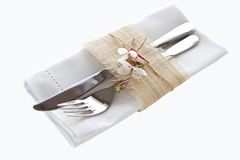 Knife and fork with napkin Stock Photo