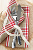 Knife and fork with napkin Royalty Free Stock Image