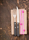 Knife and fork with napkin Royalty Free Stock Images