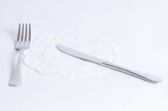 Knife, fork and napkin isolated on white background. Royalty Free Stock Photography