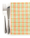 Knife and fork at napkin Stock Photos