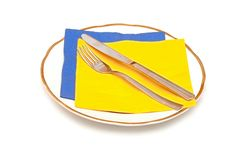 Knife fork napkin and plate Stock Photo