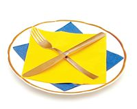 Knife fork napkin and plate Stock Photography