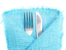 Knife, fork and a napkin on a white Royalty Free Stock Photography