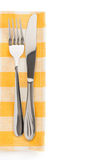 Knife and fork at napkin Stock Photography