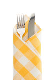Knife and fork at napkin. On white background royalty free stock images