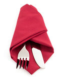 Knife and fork at napkin on white Royalty Free Stock Photos