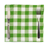 Knife and fork at napkin on white Royalty Free Stock Photography