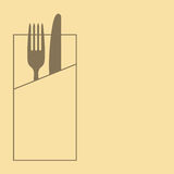 Knife, fork and napkin on yellow background Royalty Free Stock Photo