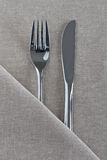 Knife and Fork on natural linen. Knife and fork as a place setting on natural linen royalty free stock image