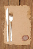 Knife and fork on old paper Royalty Free Stock Photos