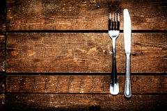 Knife and fork over wooden table with copy space. Diet Food concept. royalty free stock images