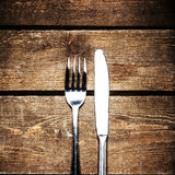 Knife and fork over wooden table with copy space. Diet Food conc Royalty Free Stock Image