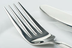Knife and fork on a plate stock images