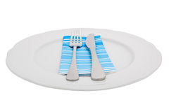 Knife and fork on a plate Stock Image