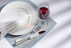 Knife, fork and plate Stock Photography