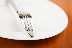 Knife and fork on plate Stock Image