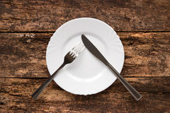 Knife and fork on the plate are as a pause Stock Photography