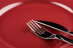 Knife and fork on a plate Royalty Free Stock Photography