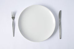 Knife and fork with plate. Knife and fork with emply plate Stock Image
