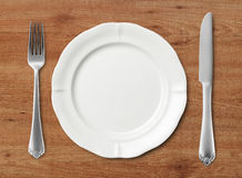 Knife, fork and plate Royalty Free Stock Image