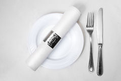 Knife, fork,  plate and napkin. In restaurant Royalty Free Stock Photo