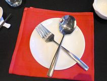 Knife and fork on the plate Stock Photography