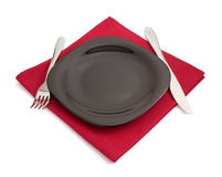 Knife and fork at plate on white Stock Photo
