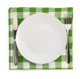 Knife and fork at plate on white Stock Image