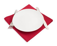 Knife and fork at plate on white Royalty Free Stock Image