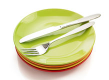 Knife and fork at plate on white Royalty Free Stock Photos