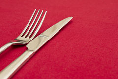 Knife and fork on red Royalty Free Stock Images