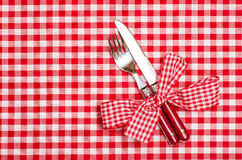 Knife and fork with red checkered bow Stock Images