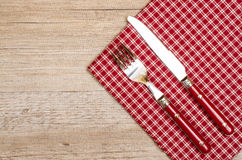 Knife and fork with red checkered napkin Stock Image