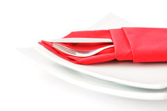 Knife and fork in a red napkin Royalty Free Stock Photos