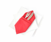 Knife and fork in a red napkin Stock Photography