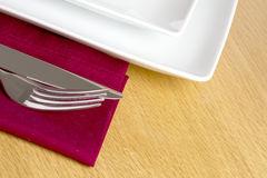Knife and fork on red napkin Stock Photo