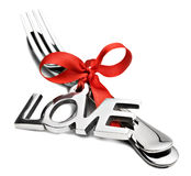 Knife and fork with a red ribbon Royalty Free Stock Photo