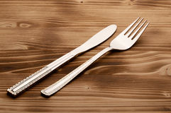 Knife and fork set on a wooden vintage table Stock Images