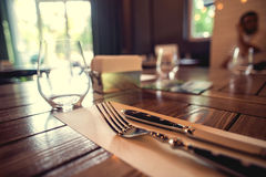 Knife and fork set on a wooden vintage table. Selective Focus.  royalty free stock photography