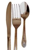 Knife fork and spoon. With golden edges Stock Images