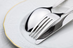 Knife, fork and spoon. On a plate royalty free stock image