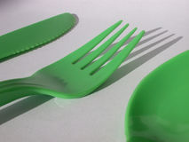Knife fork and spoon. Green knife fork and spoon on white background stock image