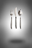 Knife, fork and spoon Stock Images